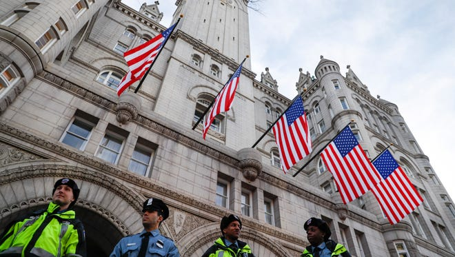 In this Jan. 19, 2017, file photo, police stand guard outside the Trump International Hotel on Pennsylvania Avenue in Washington.