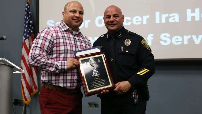 Senior Officer Ira Herrero, left, and Police Chief Mike Markle at a Corpus Christi police retirement party Friday, Feb. 3, 2017.