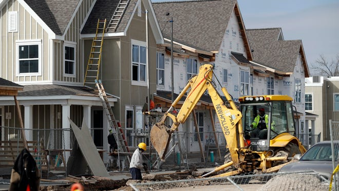 In this photo made Monday, Jan. 30, 2017, new housing under construction in St. Louis. The development is receiving federal low-income housing tax credits. (AP Photo/Jeff Roberson)