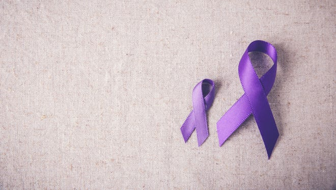 Purple ribbons for domestic abuse awareness.