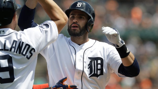 Detroit Tigers' J.D. Martinez is congratulated at home plate after his three-run home run during the third inning of a baseball game against the Baltimore Orioles, Thursday, May 18, 2017, in Detroit.