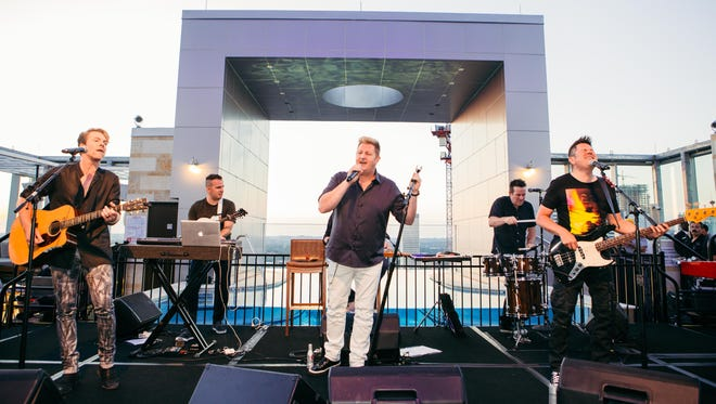 Joe Don Rooney, Gary LeVox and Jay DeMarcus of Rascal Flatts play a rooftop album release party at The Westin Nashville.