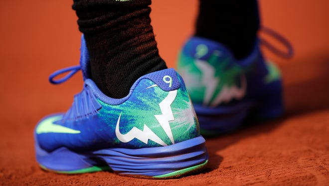 Spain's Rafael Nadal's shoes bear the number nine for nine French Open victories as he plays against Switzerland's Stan Wawrinka during their men's final match of the French Open tennis tournament at the Roland Garros stadium, in Paris, France, Sunday, June 11, 2017. (AP Photo/Christophe Ena)