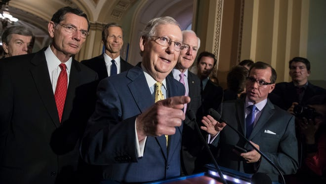 """Senate Majority Leader Mitch McConnell, R-Ky., joined by, from left, Sen. John Barrasso, R-Wyo., Sen. John Thune, R-S.D., and Majority Whip John Cornyn, R-Texas, meets with reporters following a closed-door strategy session, at the Capitol in Washington, Tuesday, June 20, 2017. Sen. McConnell says Republicans will have a """"discussion draft"""" of a GOP-only bill scuttling former President Barack Obama's health care law by Thursday."""