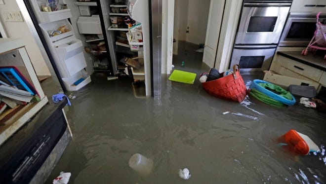 The kitchen of the Kirby home is filled with floodwater in the aftermath of Hurricane Harvey, Monday, Sept. 4, 2017, near the Addicks and Barker Reservoirs, in Houston. The Las Cruces-based company A Striking Image is in the Houston area this week helping homeowners dry out.