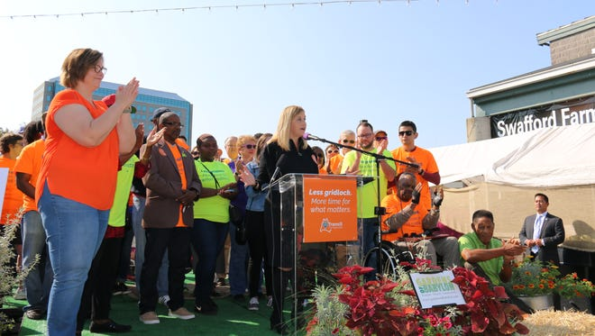 Nashville Mayor Megan Barry calls for residents to sign a petition supporting mass transit funding on Saturday, Sept. 9, 2017.