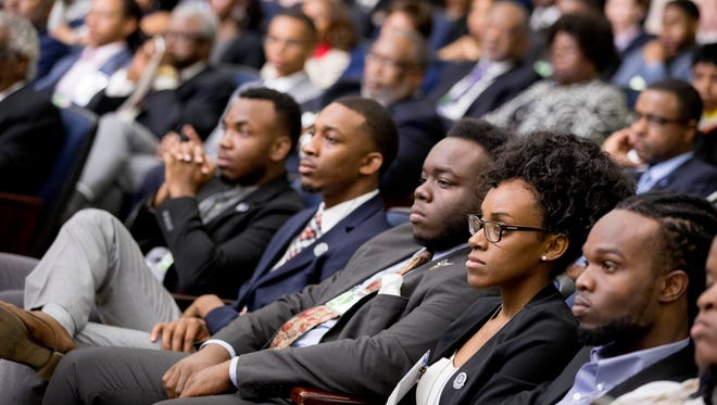 Members of the audience listen as Education Secretary Betsy DeVos speaks during the White House Summit on Historically Black Colleges and Universities at the White House complex, Monday, Sept. 18, 2017, in Washington.