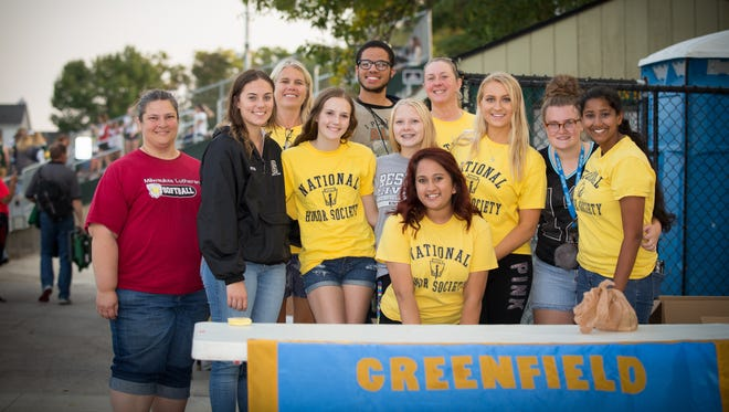 Greenfield and Milwaukee Lutheran National Society Members set up a booth to collect food cans before the Greenfield-Milwaukee Lutheran football game Friday, Sept. 15.