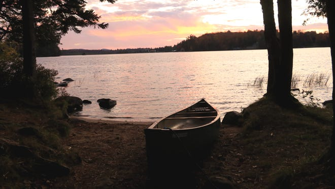 Our canoe rests on a beach during sunset on the big island of  Raquette Lake on October 7, 2017.