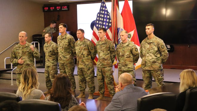 Col. Derek Thomson, 1st Brigade Combat Team, 101st Airborne Division commander, introduces six soldiers before they received the Soldier's Medal at Fort Campbell Nov. 28. The soldiers earned the highest peacetime award for valor for their life-saving actions following a UH-60 Blackhawk helicopter crash, Jan. 31.