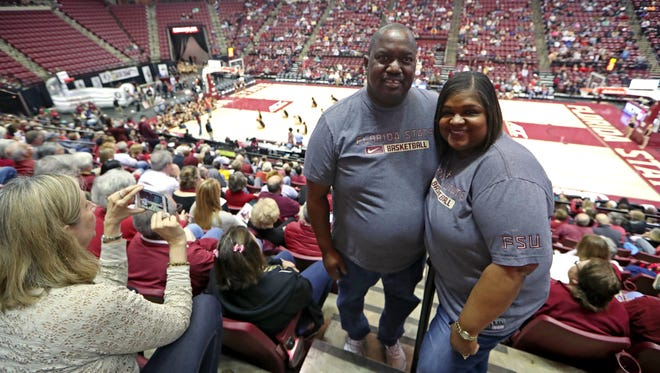 FSU fans John Pride and his wife Alesia in the stands to cheer on the Seminoles during their game against Arizona State at the Tucker Civic Center on Sunday.