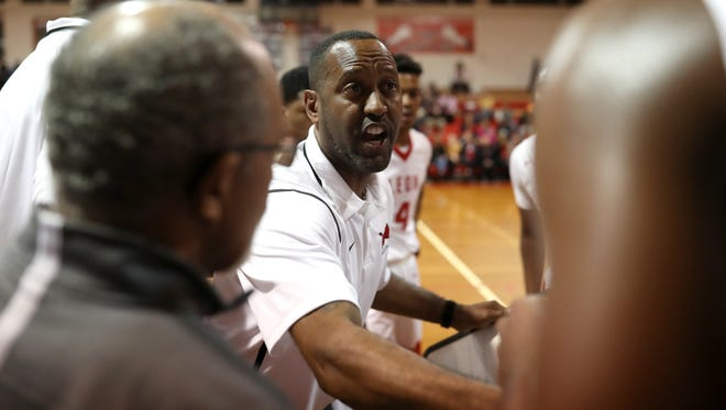 Leon Head Coach Rick Davis talks to his team during a timeout in their game against Lincoln at Leon High School on Friday, Jan. 19, 2018.