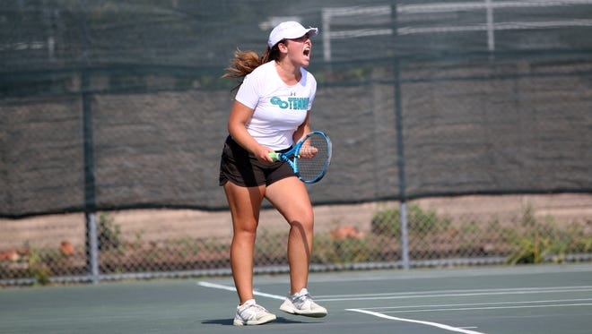 Emma Schilling reacts to winning her match during the Class 3A regional semifinal match between Gulf Coast and Venice at Gulf Coast High School on Tuesday, April 24, 2018.