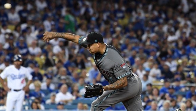 October 6, 2017; Los Angeles, CA, USA; Arizona Diamondbacks starting pitcher Taijuan Walker (99) throws during the first inning against the Los Angeles Dodgers in game one of the 2017 NLDS at Dodger Stadium. Mandatory Credit: Richard Mackson-USA TODAY Sports