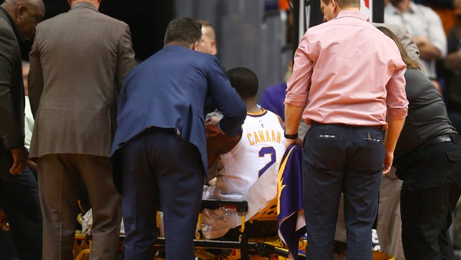 Jan 31, 2018: Phoenix Suns guard Isaiah Canaan is stretchered off the court by medical personnel after suffering a leg dislocation injury in the first quarter against the Dallas Mavericks at Talking Stick Resort Arena.