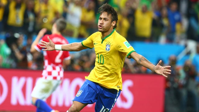 Brazil forward Neymar (10) celebrates after scoring a goal against Croatia in the first half of the opening game of the 2014 World Cup at Arena Corinthians.