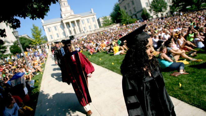 UI faculty and administrators make their way from the Old Capitol to their center stage on the west side of the Pentacrest for convocation ceremonies on Sunday, August 22, 2010. Around 2,000 students were in attendance for the second annual celebration.