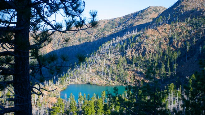 A view of Vulcan Lake in its orange basin in the Kalmiopsis Wilderness.