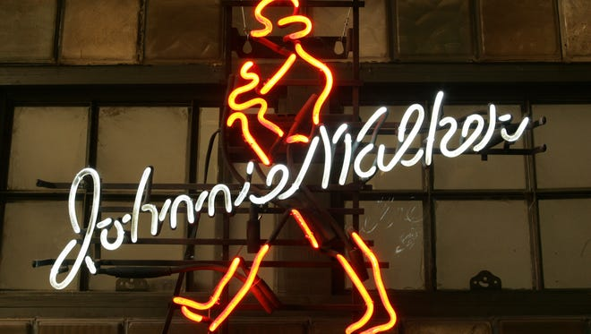 Johnnie Walker neon sign in the Bada Bing back room behind the scenes of the Sopranos set at Silver Cup studios in Queens, New York.