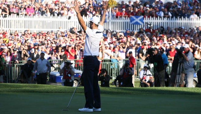 European golfer Martin Kaymer celebrates the winning putt on the 18h green to give Europe the victory over the United States during the 39th Ryder Cup on day three at Medinah Country Club. Europe defeats the United States 14 1/2 to 13 1/2 in September 2012.