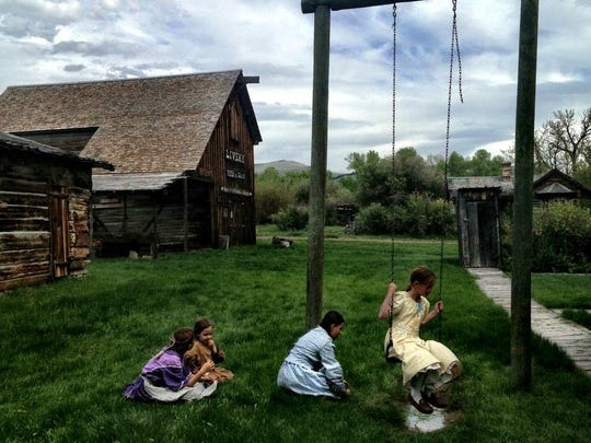 Girls in period costumes play at the Nevada City Living