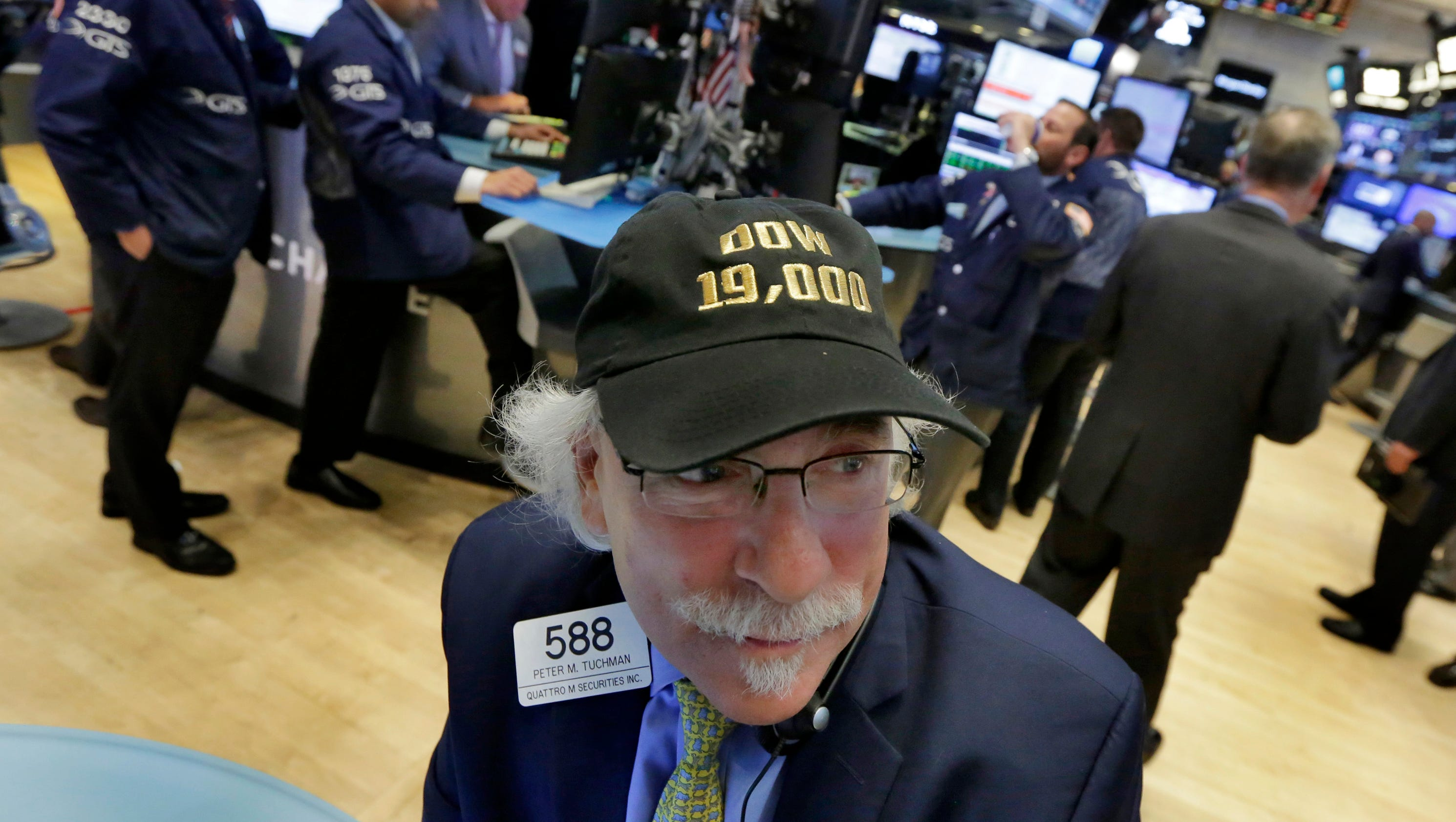 Dow closes above 19,000 for first time in its 120-year history