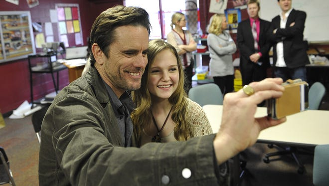 "Charles Esten of ABC's ""Nashville"" takes a selfie with Marcella Jones at Nashville School of the Arts."