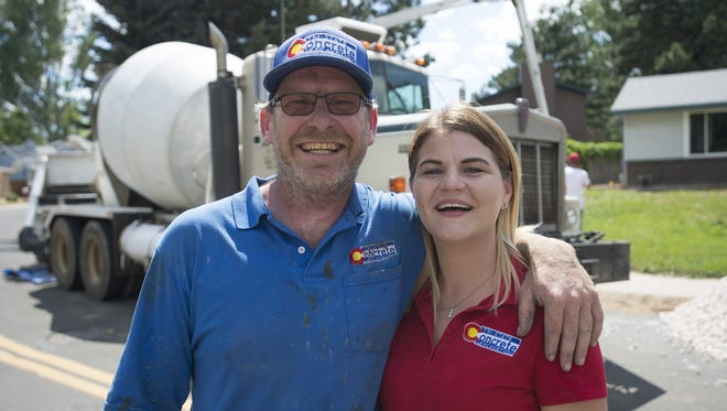 Erik and Kim Whitin, owners of Tri-State Concrete and Excavation, pose for a photo at a job site in central Fort Collins on Wednesday, June 21, 2017. The two lost their Stove Prairie home and business in the High Park Fire five years ago and are up and running again after help from the community.