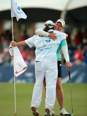 Brittany Lincicome hugs her caddie Missy Pederson after sinking a putt on the third playoff hole to win the ANA Inspiration on Sunday, April 5, 2015 at Mission Hills Country Club in Rancho Mirage, Calif. Lincicome eagled the 18th hole at the end of her round to force a playoff with Stacy Lewis, who also finished the tournament at nine under.