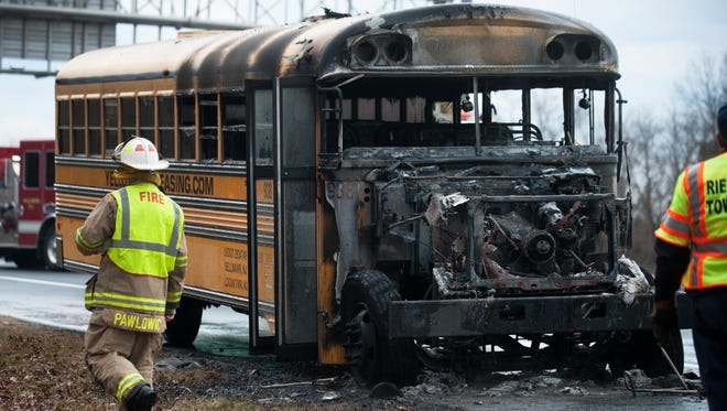 Officials work the scene of a bus fire that occurred on Route 295 South near Exit 18 in Paulsboro.