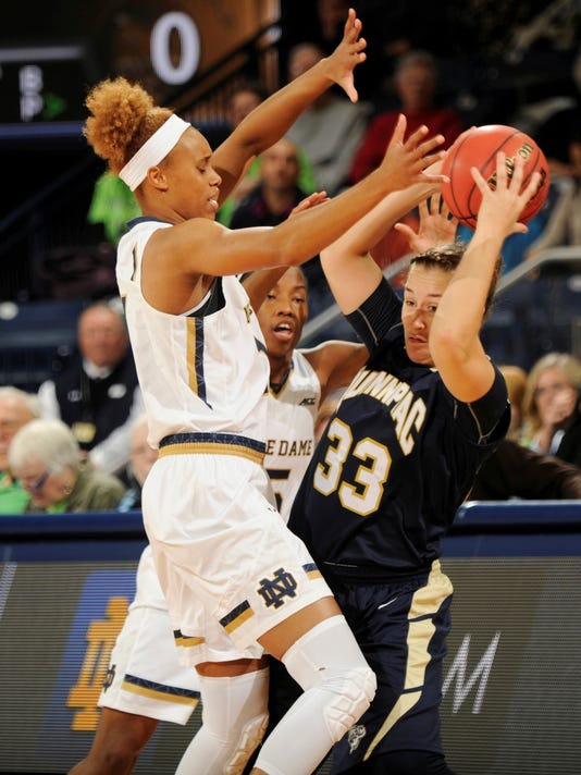 Quinnipiac guard Gillian Abshire, right, attempts to pass around Notre Dame forward Brianna Turner, left and guard Lindsay Allen in the first half of an NCAA college basketball game, Tuesday, Nov. 25, 2014, in South Bend, Ind. (AP Photo/Joe Raymond)