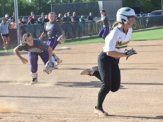 Rosepine's pitcher Morghan LaTour (17, left) throws to first for an out against Holy Savior Menard's Morgan Woodard (1, right) who hit a sacrifice bunt to advance a runner.