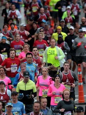 Runners line up downtown for the 15th annual St. Jude Memphis Marathon Saturday morning.