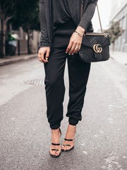 Joggers usually have an elasticized waist, are relaxed through the hips and legs, and then have an elasticized ankle. They look amazing with button downs, loose sweaters, or even with a silky cami with a blazer over the top.