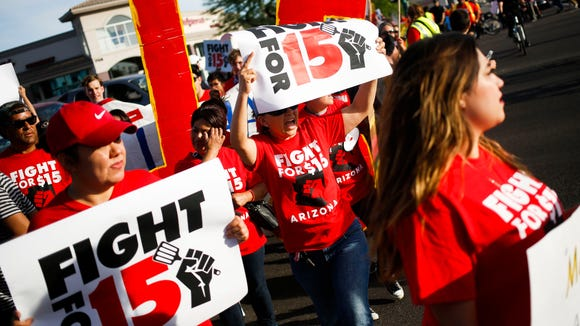 Protesters, activists, and fast food workers march outside McDonalds during a demonstration for an increased minimum wage on Thursday, April 14, 2016, on 7th Street and McDowell in Phoenix, Ariz.