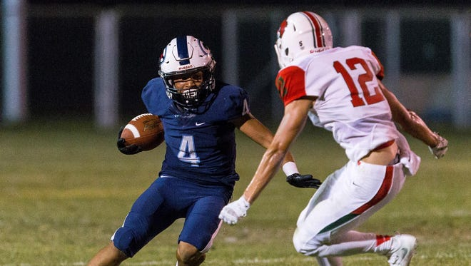Central Valley Christian's Jaalen Rening attempts to get away from a Lindsay defender earlier this season in a non-league game.