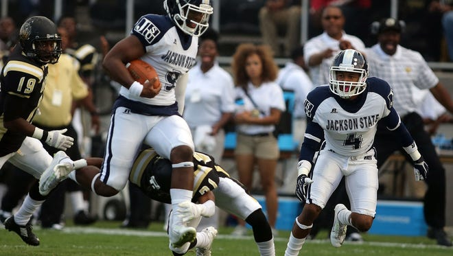 Charles A. Smith/Special to The Clarion-Ledger Jackson State quarterback LaMontiez Ivy and the offense hope to build upon their spotless performance from the Arkansas-Pine Bluff game. Jackson State quarterback LaMontiez Ivey breezes through the arms of a UAPB defender, Saturday, September 27, 2014 in Pine Bluff, Ark. (Charles A. Smith/JSU Communications)