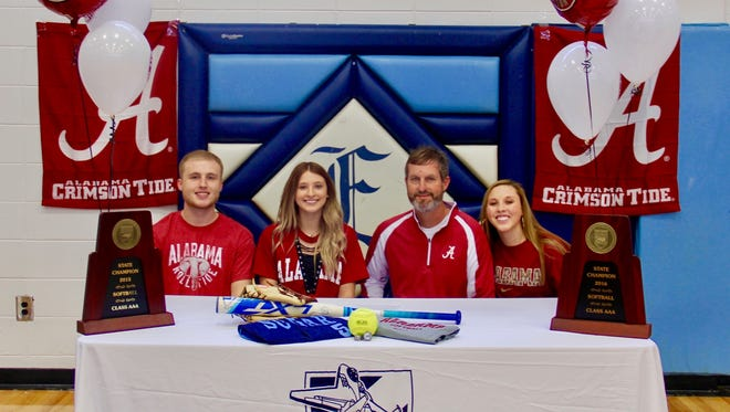 Enka's Kloyee Anderson, second from left, signed to play softball for Alabama. With her are (from left) her brother Cole, dad Mark and sister Kylie.