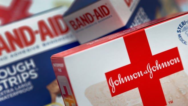 File photo taken in 2012 shows Johnson & Johnson products, including Band Aid brand adhesive trips.