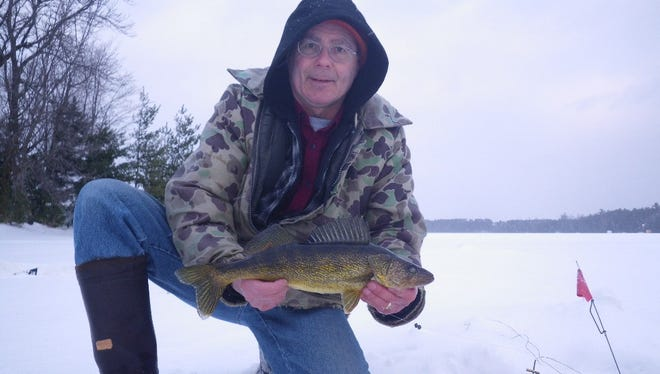 Skip Sommerfeldt with a walleye caught in February 2015.