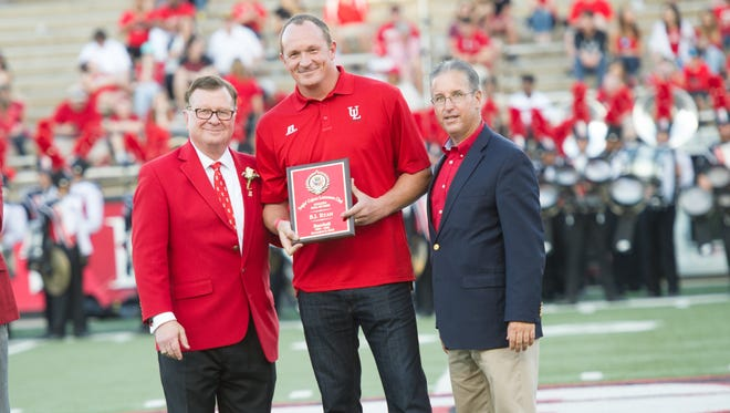 Former All-Star and Ragin' Cajuns pitcher B.J. Ryan, center, is set to be named the Ragin' Cajuns' new pitching coach according to a source. UL President Joseph Savoie, left, and former athletic director Scott Farmer are also pictured as Ryan was honored as a new UL Hall of Famer in 2016.