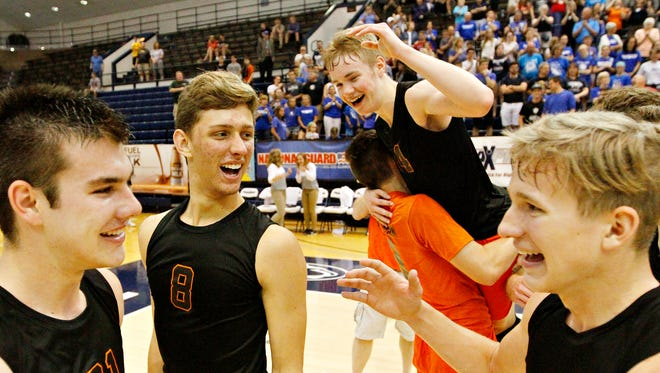 Northeastern's Cole Brillhart (21), Drew Wilson (8), Jacob Cheuvront (14) and Wyatt Huges celebrate the team's 3-1 win over Beaver County Christian during PIAA boys' state volleyball championship action at Rec Hall in State College, Saturday, June 10, 2017. The state title is the fifth in a row for the Bobcats. Dawn J. Sagert photo