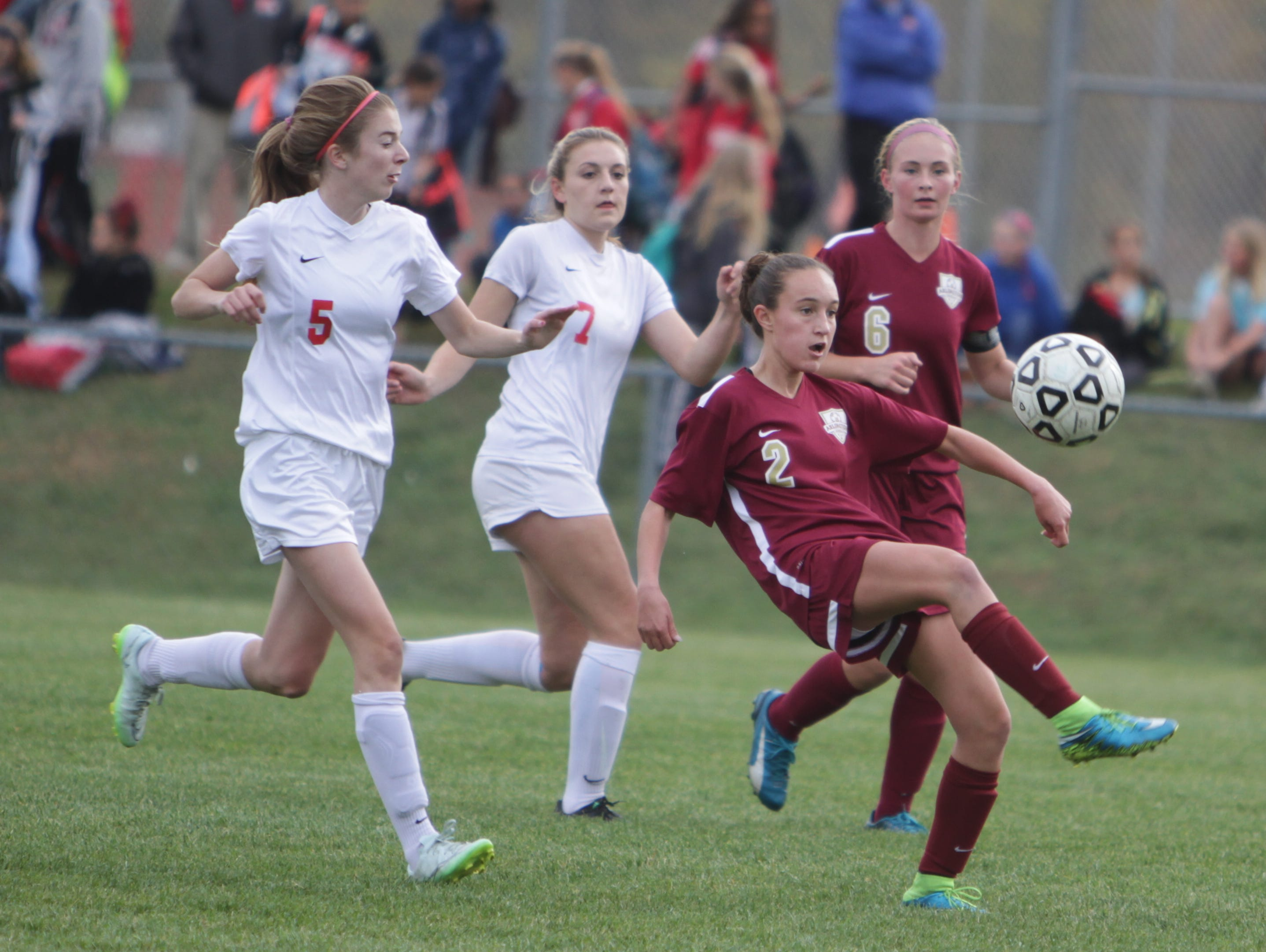 Arlington's Megan Buttinger attempts to kick the ball over her head during a Section 1, Class AA quarterfinal game at North Rockland High School on Tuesday, October 27th, 2015. North Rockland won 2-0.