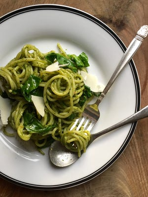 Spinach pesto over noodles.