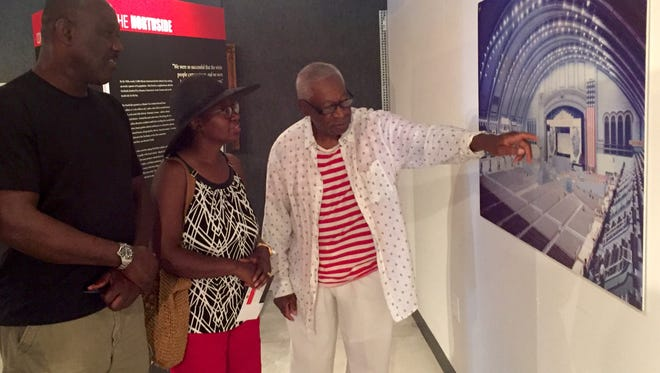 Ralph Hunter, founder of the African American Heritage Museum of Southern New Jersey, talks about the exhibit with Emmanuella and Ducheine Previlon from Jamesburg.