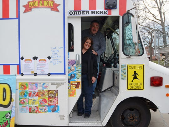 Owners of the new Food On The Move food truck, Chuck and Laura Seigneurie, Sunday, April 24, at Pine Grove Park in Port Huron.