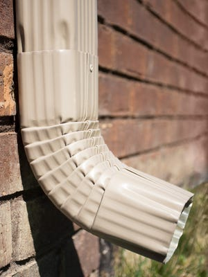The downspout of a gutter on a house should have an extension on it preventing water to soak the ground near the foundation.