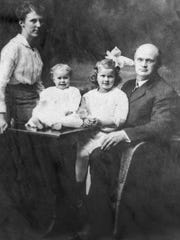 Middlebury's Dr. and Mrs. Jacob Ross with children Katherine and Ruth. Dr. Ross served as a flight surgeon in World War I in France.