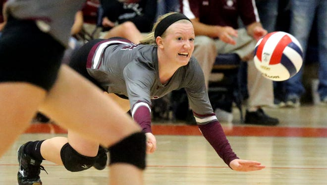 Eagleville's Kristin Barnes dives for a ball during the first round of the TSSAA Class A state volleyball tournament against Jackson County, on Wednesday, Oct. 21, 2015, at Blackman.