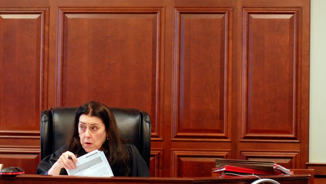 Bullitt Family Court Judge Elise Givhan Spainhour reviewed cases during a hearing in 2016.